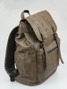 Picture of Back pack in brown with flap and usb port on the side